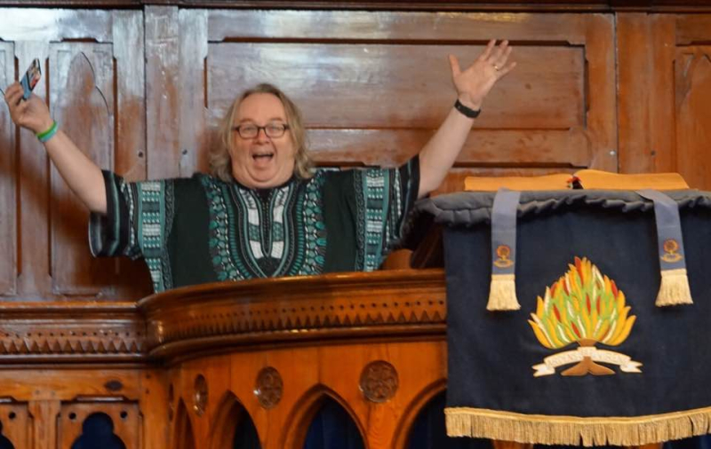 Stocki smiling in pulpit