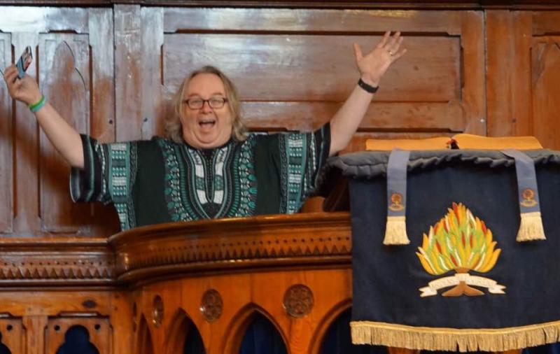 Stocki smiling in pulpit